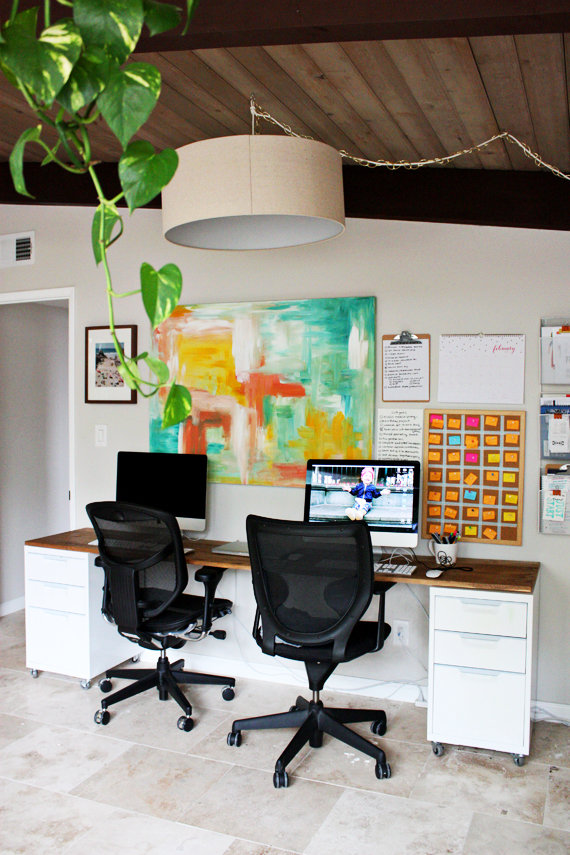 home office space, desk made of two file cabinets and wood